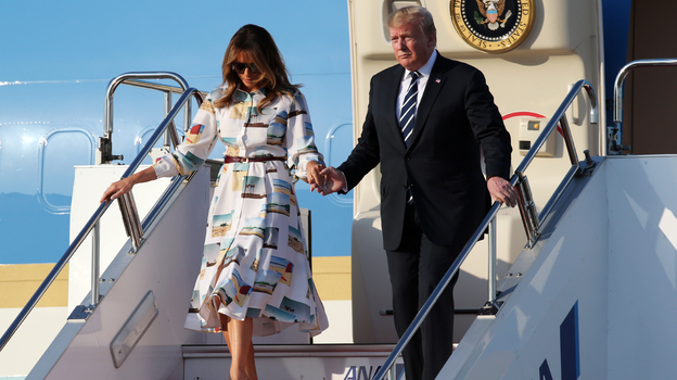 President Trump and first lady Melania arrive in Tokyo. North Korea and trade are expected to be on the weekend's agenda. (Koji Sasahara/AP)