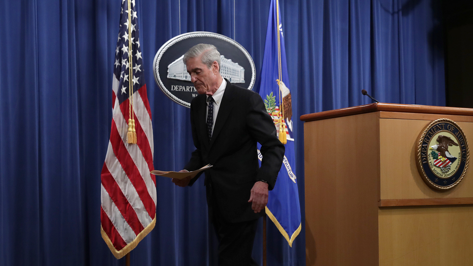 "Special counsel Robert Mueller leaves after making a statement about the Russia investigation on Wednesday at the Justice Department. After the investigation, he said, ""if we had had confidence that the president clearly did not commit a crime we would have said so."" (Chip Somodevilla/Getty Images)"