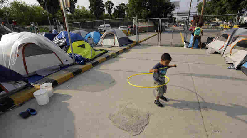 As The Line Into America Slows, Communities Form, And Wait, On The Mexican Side