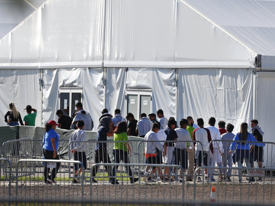 Children line up to enter a tent at the Homestead Temporary Shelter for Unaccompanied Children in Homestead, Fla., in February. (Wilfredo Lee/AP)
