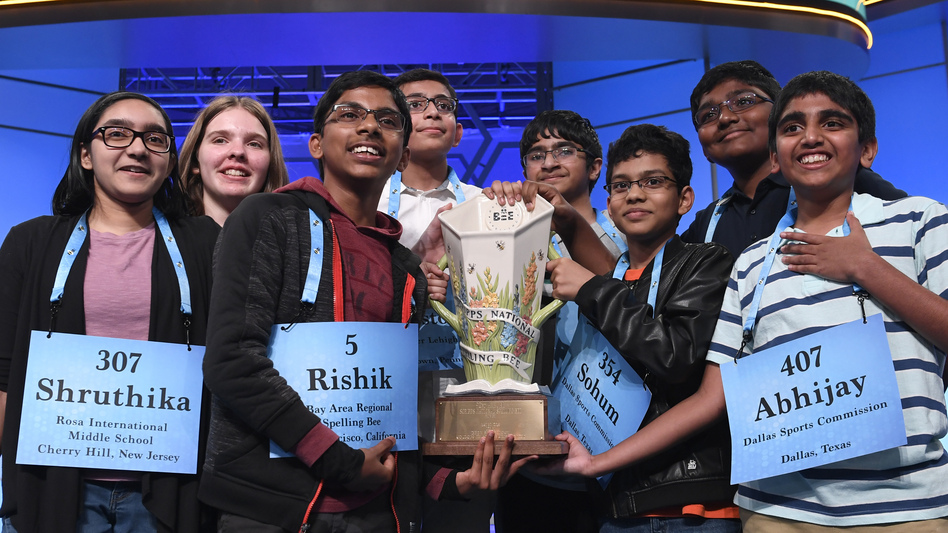Co-champions of the 2019 Scripps National Spelling Bee (from left) Shruthika Padhy, Erin Howard, Rishik Gandhasri, Christopher Serrao, Saketh Sundar, Sohum Sukhatankar, Rohan Raja and Abhijay Kodali hold the trophy in Oxon Hill, Md., on Friday.