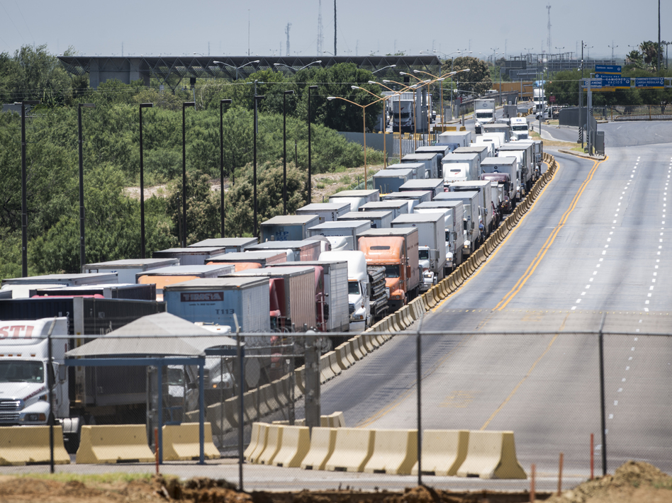Traffic backs up along the route to the border crossing from Mexico to the U.S. in Laredo, Texas in 2015. Mexico recently surpassed China and Canada as America's top trading partner, which helped catapult Laredo past Los Angeles to become the number one port in the country. (Matthew Busch/Getty Images)