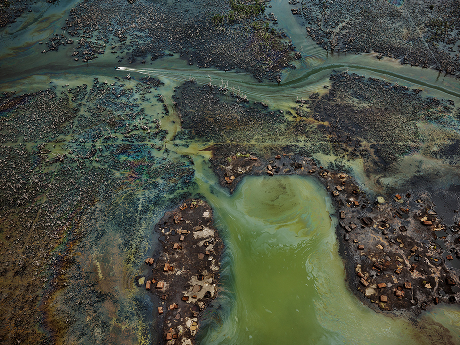 """In Nigeria's oil-rich Niger Delta, oil bunkering — the practice of siphoning oil from pipelines — has transformed parts of the once-thriving delta ecosystem into an ecological dead zone, <a href=""""https://postconflict.unep.ch/publications/OEA/UNEP_OEA.pdf"""">according to the U.N. Environment Programme</a>. (Edward Burtynsky, courtesy Robert Koch Gallery, San Francisco /  Nicholas Metivier Gallery, Toronto)"""