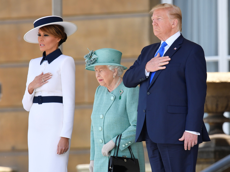 President Trump and first lady Melania Trump were welcomed to the U.K. by Queen Elizabeth II in a ceremony Monday at Buckingham Palace. (Toby Melville/Reuters)