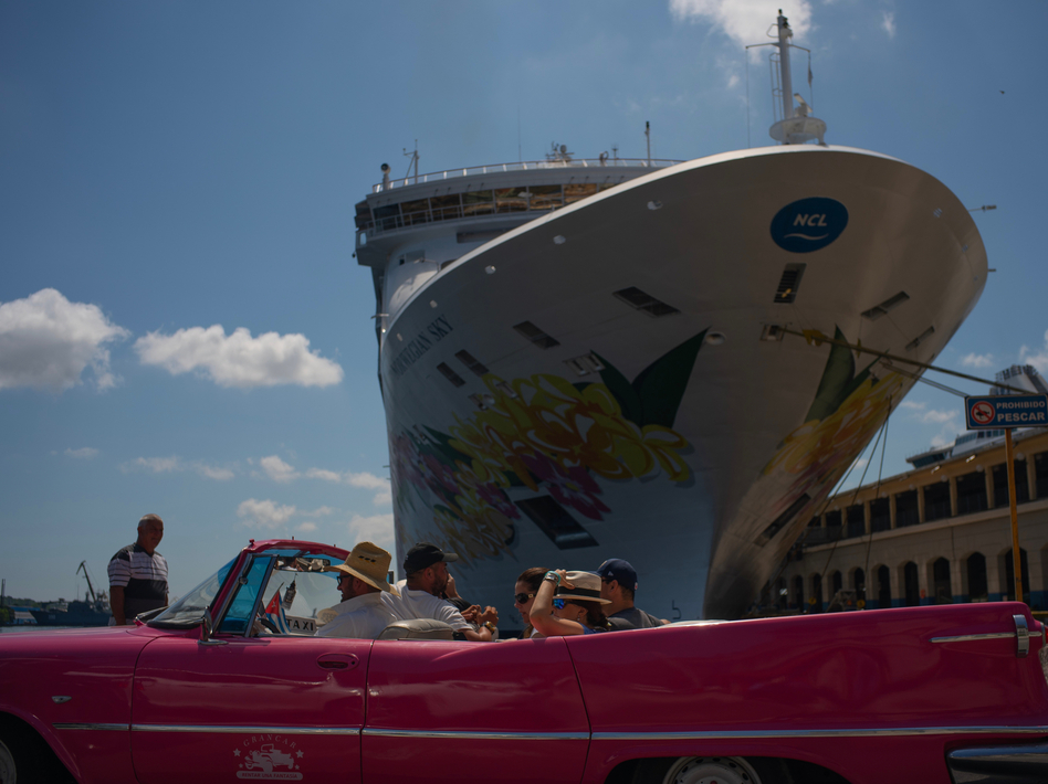 Tourists who have just disembarked from a cruise liner tour Havana on Tuesday. The Trump administration has imposed major new travel restrictions on visits to Cuba by U.S. citizens. (Ramon Espinosa/AP)