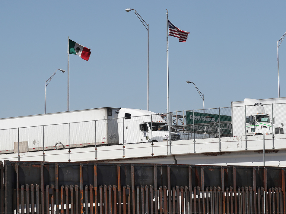 Trucks are seen heading into the United States from Mexico along the Bridge of the Americas in El Paso, Texas, on Tuesday. U.S. industries say President Trump's threatened tariffs on goods from Mexico raised uncertainty just as they were looking forward to a new trade agreement. (Joe Raedle/Getty Images)