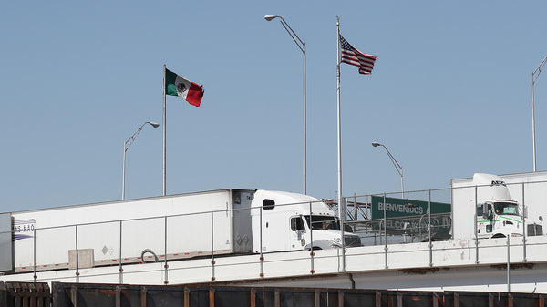Trucks are seen heading into the United States from Mexico along the Bridge of the Americas in El Paso, Texas, on Tuesday. U.S. industries say President Trump