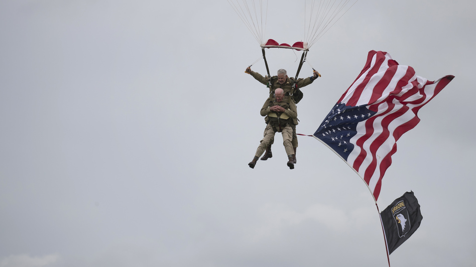 U.S. World War II D-Day veteran Tom Rice, from Coronado, Calif., parachutes in a tandem jump into a field in Carentan, Normandy, France, on Wednesday. Approximately 200 parachutists participated in the event, replicating a jump made by U.S. soldiers on June 6, 1944 — D-Day. (AP)