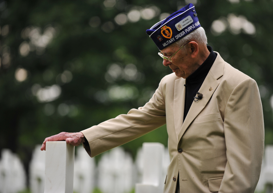 Leslie Cruise, a World War II veteran, pays his respects to Pvt. Richard Vargas during a wreath-laying ceremony at Lorraine American National Cemetery and Memorial, St. Avold, France, on June 2, 2014. (Senior Airman Hailey Haux/U.S. Air Force)