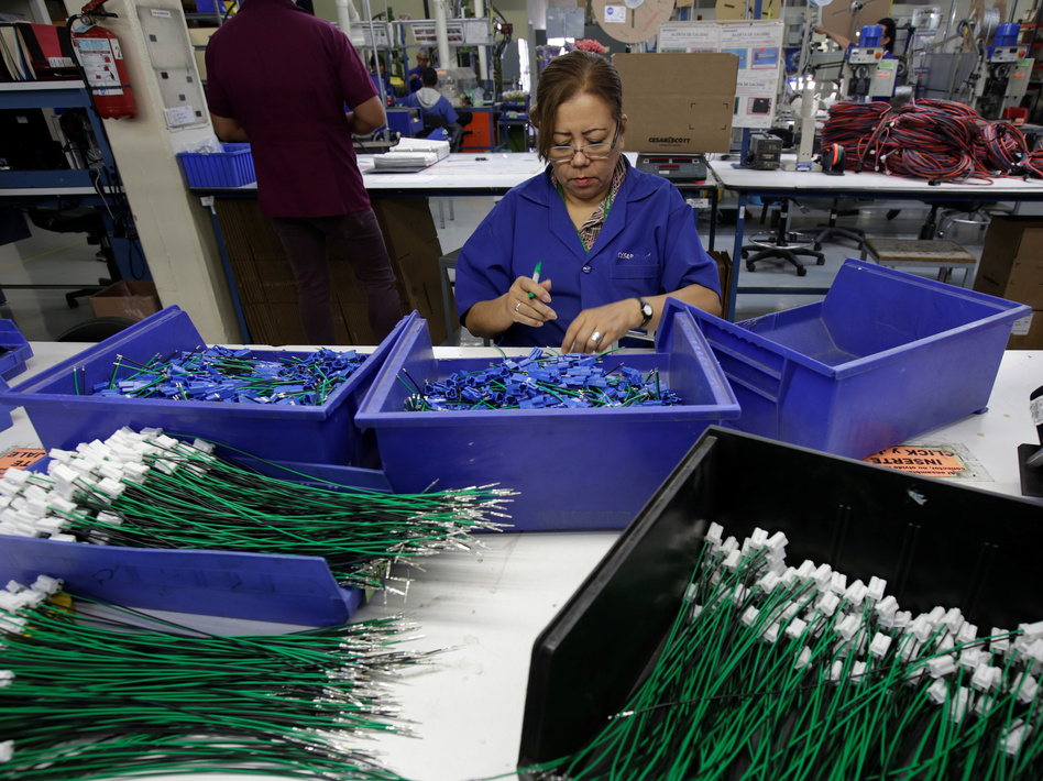 An employee works at a wiring harness and cable assembly manufacturing company in Ciudad Juárez, Mexico, that exports to the U.S. in 2017. The auto industry says threatened tariffs would play havoc with supply chains. (Jose Luis Gonzalez/Reuters)