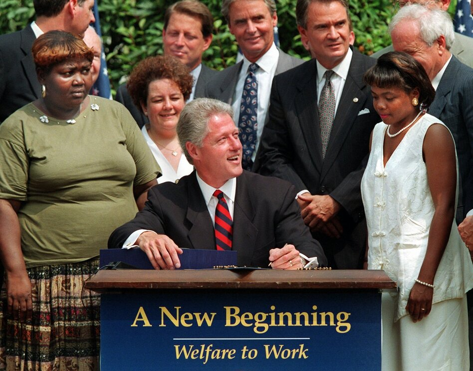 Lillie Harden and Penelope Howard, two former welfare recipients, were invited guests to President Clinton's signing of the law that would place new requirements and restrictions on welfare. (J. SCOTT APPLEWHITE/ASSOCIATED PRESS)