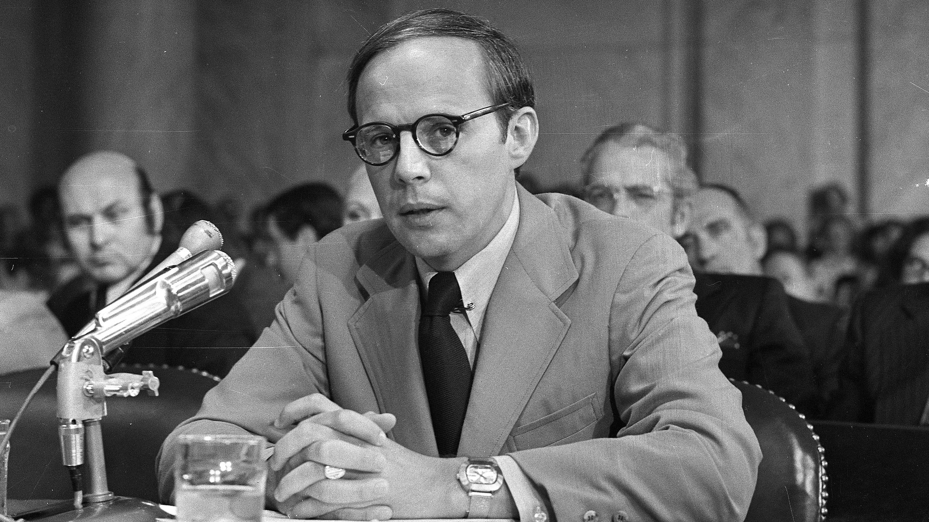 Former White House aide John Dean pauses while reading a prepared statement before the Senate Watergate Committee on June 25, 1973. Dean has returned to public view as a CNN contributor and vocal critic of President Trump.