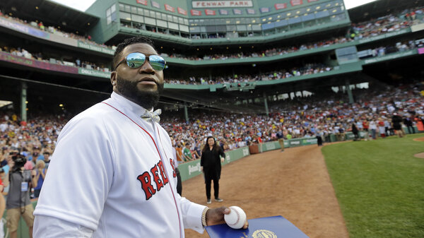 Retired Boston Red Sox player David Ortiz looks at the large television screen last June at Fenway Park in Boston.