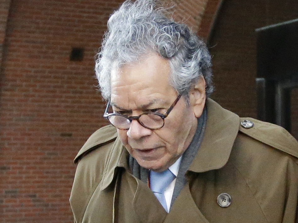 Insys Therapeutics founder John Kapoor departs federal court in Boston, Jan. 30. On Monday the company filed for Chapter 11 bankruptcy, saying it needs to sell its assets to pay back creditors. Kapoor, who was convicted last month of racketeering, owns more than 63% of the company. (Steven Senne/AP)