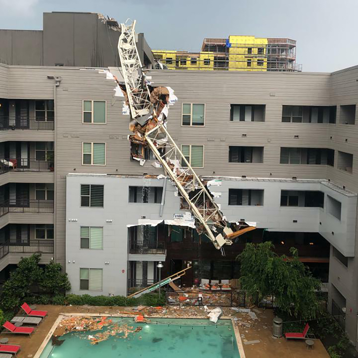The City Apartments: Crane Collapse In Dallas: High Winds Topple Crane Onto