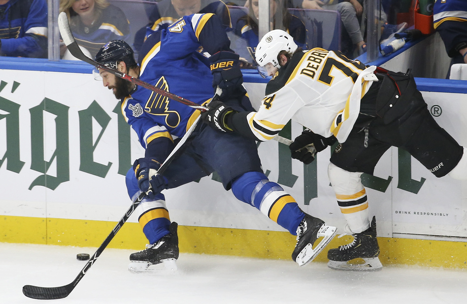 Boston Bruins left wing Jake DeBrusk (right) tries to stop St. Louis Blues defenseman Robert Bortuzzo during Game 6 of the Stanley Cup Final Sunday in St. Louis. The Bruins won, forcing a Game 7 on Wednesday. (Scott Kane/AP)