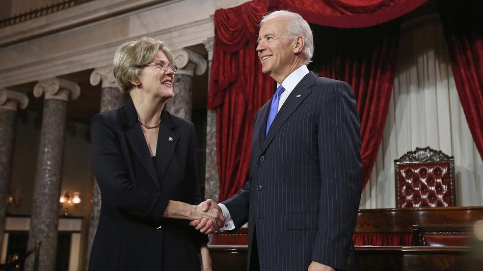 U.S. Sen. Elizabeth Warren participates in a re-enacted swearing-in with U.S. Vice President Joe Biden at the U.S. Capitol on Jan. 3, 2013. (Chip Somodevilla/Getty Images)