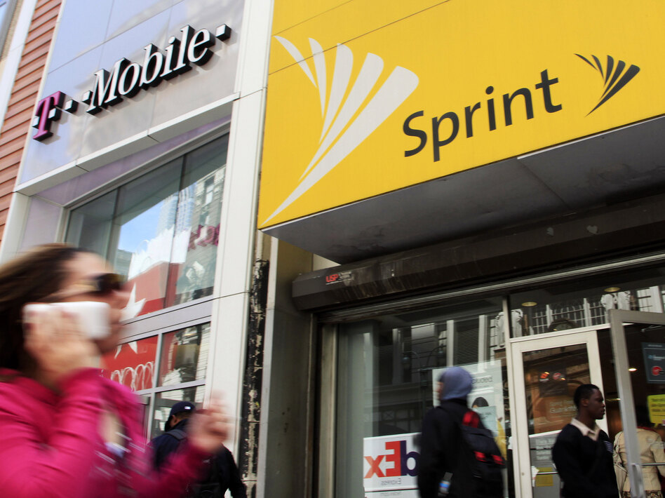 Ten state attorneys general are suing T-Mobile and Sprint to try to block their merger. (Mark Lennihan/AP)