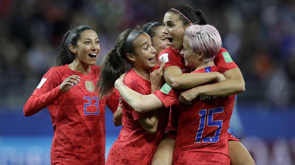 Alex Morgan (second right) celebrates after scoring the United States' 12th goal during the team's 13-0 win over Thailand Tuesday. (Alessandra Tarantino/AP)