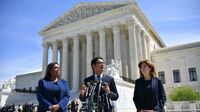 ACLU's Voting Rights Project Director Dale Ho (center) speaks outside the U.S. Supreme Court in April after arguing on behalf of plaintiffs in the lawsuits over the citizenship question the Trump administration wants to add to the 2020 census.