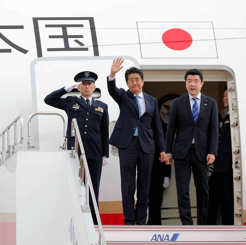 Japan's Prime Minister Shinzo Abe waves to well-wishers on his departure from Tokyo's Haneda Airport on Wednesday for a two-day visit to Iran. (Jiji Press/AFP/Getty Images)