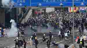 Hong Kong Police Use Tear Gas, Rubber Bullets In Clashes With Thousands Of Protesters