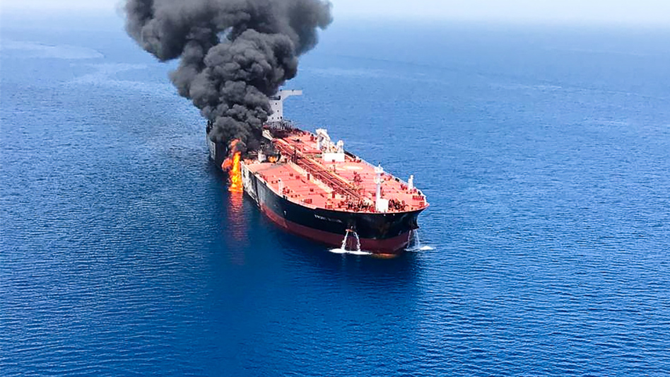 A picture obtained from  Iranian News Agency ISNA on Thursday shows fire and smoke billowing from Norwegian-owned Front Altair tanker said to have been attacked in the waters of the Gulf of Oman. (AFP/Getty Images)