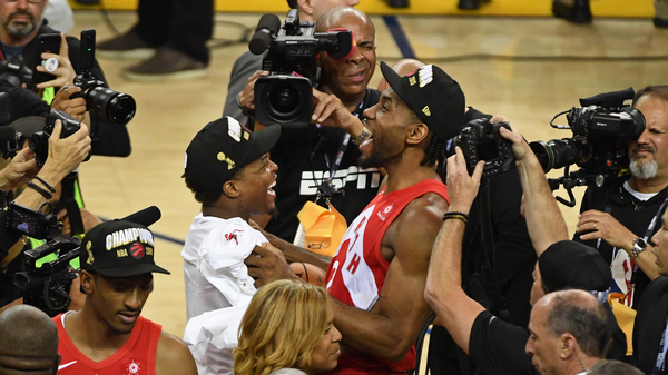 The Raptors' Kawhi Leonard and Kyle Lowry celebrate after Toronto wins the NBA championship, defeating the Golden State Warriors 114-110 in Oakland, Calif.