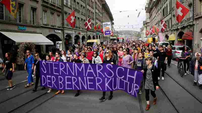 'Wages. Time. Respect': Swiss Women Go On Strike