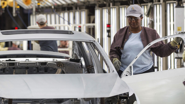 Workers produce vehicles at Volkswagen