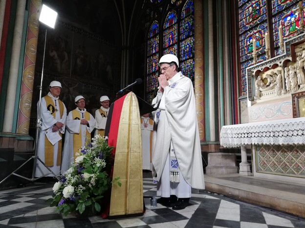 A small group in hard hats gathered on Saturday for Mass in Paris' Notre Dame cathedral. It was the first Mass since a fire devastated the church in April. (Karine Perret/AFP/Getty Images)