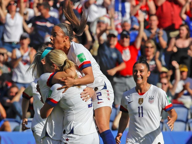 U.S. players celebrate after teammate Julie Ertz scored their side's second goal during the Women's World Cup Group F soccer match between United States and Chile at Parc des Princes in Paris, France on Sunday. (Alessandra Tarantino/AP)