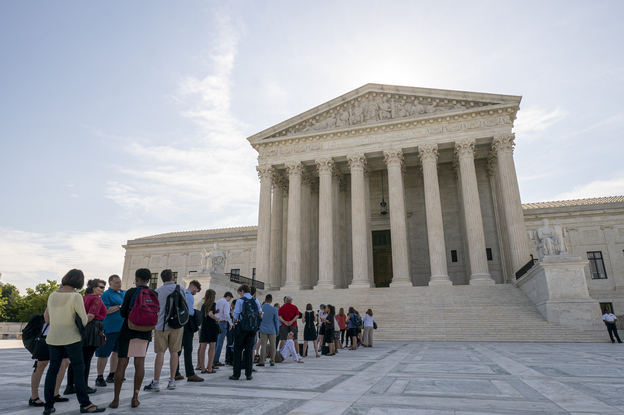 Visitors lined up at the Supreme Court in Washington, D.C., on Monday morning as the justices prepared to hand down decisions. (J. Scott Applewhite/AP)