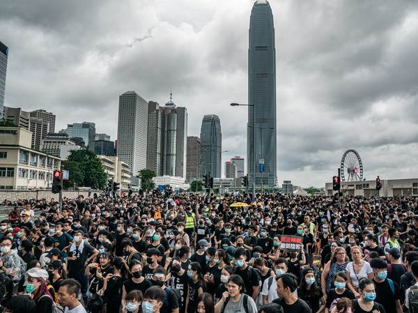 Protesters demonstrate outside the Chief Executive Office on Monday in Hong Kong.