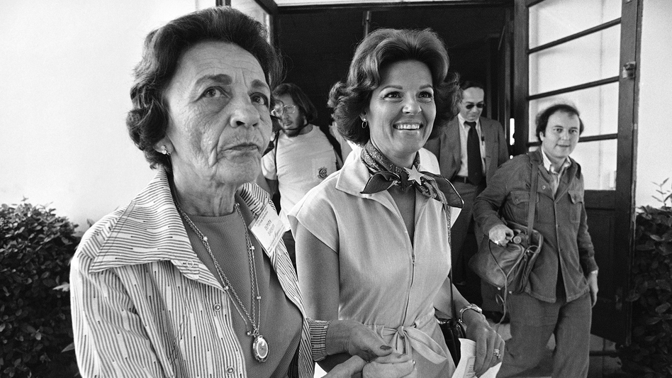 Singer Anita Bryant (right) is led to the voting booth at her Miami Beach polling place by volunteer Leah Dezen in 1977. Bryant was the leader of the opposition group Save Our Children, whose members pushed for the repeal of a gay-rights ordinance in Miami-Dade County. (Kathy A. Willens/AP)
