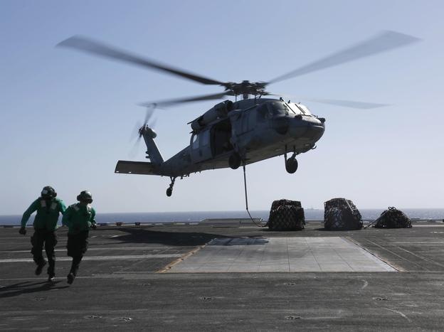 A MH-60S Sea Hawk helicopter takes off from the aircraft carrier USS Abraham Lincoln in the Red Sea. The Abraham Lincoln Carrier Strike Group was recently deployed to U.S. Central Command area of responsibility as tensions between the U.S. and Iran escalate. On Monday, the State Department ordered additional troops to the Middle East. (Mass Communication Specialist 3rd Class Amber Smalley/U.S. Navy via Getty Images)
