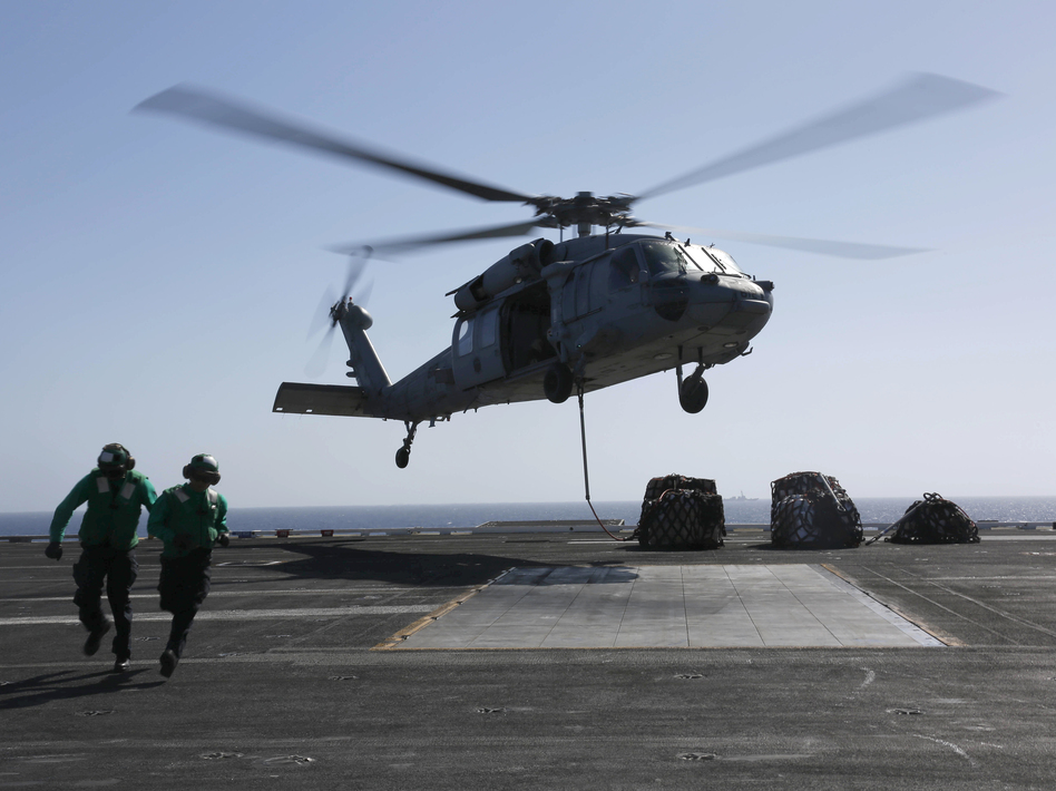 An MH-60S Sea Hawk helicopter takes off from the aircraft carrier USS Abraham Lincoln in the Red Sea. The Abraham Lincoln Carrier Strike Group was recently deployed to the U.S. Central Command area of responsibility as tensions between the U.S. and Iran escalate. On Monday, the State Department ordered additional troops to the Middle East. (Mass Communication Specialist 3rd Class Amber Smalley/U.S. Navy via Getty Images)