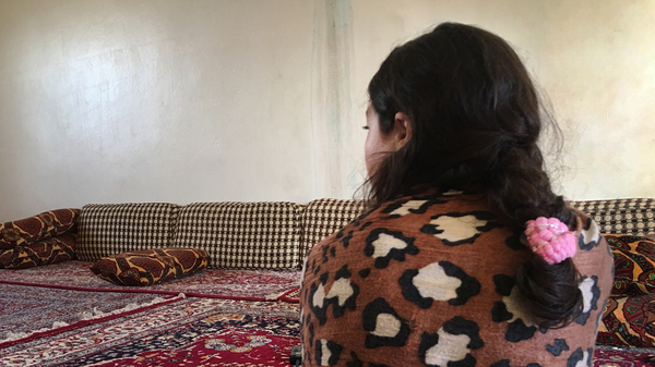 Jeelan, 11, the day after being rescued from an ISIS family who had held her captive for the past two years. She says she doesn