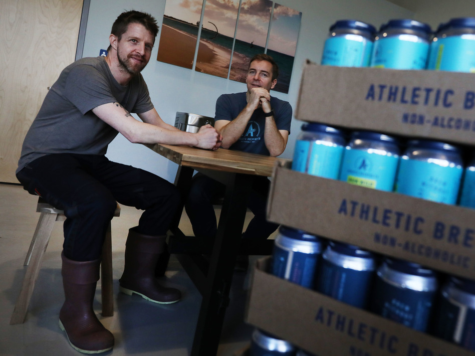 Athletic Brewing Co. co-founders Bill Shufelt (right) and John Walker, here at the company's production plant in Stratford, Conn., have created a range of high-quality nonalcoholic beers to provide people more options when they're out socializing. (Spencer Platt/Getty Images)