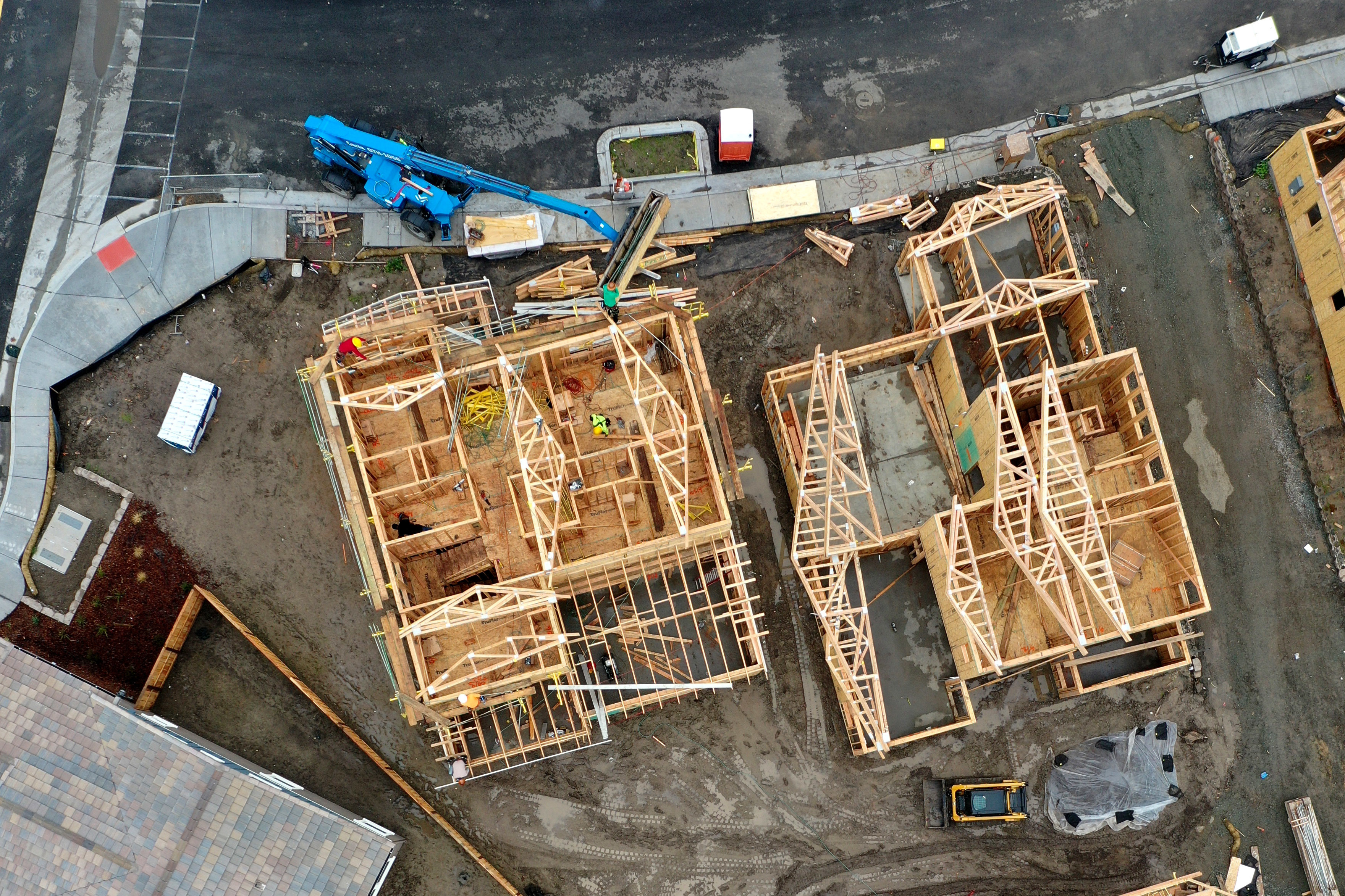 An aerial view shows homes under construction at a housing development in Petaluma, Calif., in January. As housing prices surge around the country, Democratic presidential candidates are offering plans to address the shortage of affordable homes and apartments.