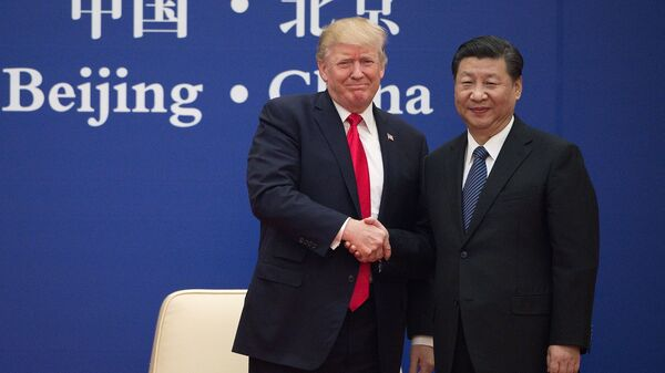 President Trump and Chinese President Xi Jinping shake hands during a business leaders event in Beijing on Nov. 9, 2017. The two leaders are expected to discuss trade at this week