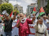 Palestinians in the occupied West Bank town of Ramallah protest the Trump administration's new peace plan on June 15.