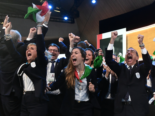 Members of the delegation from Milan and Cortina d'Ampezzo react after the Italian cities were named to host the 2026 Olympic Winter Games. (Philippe Lopez/AFP/Getty Images)
