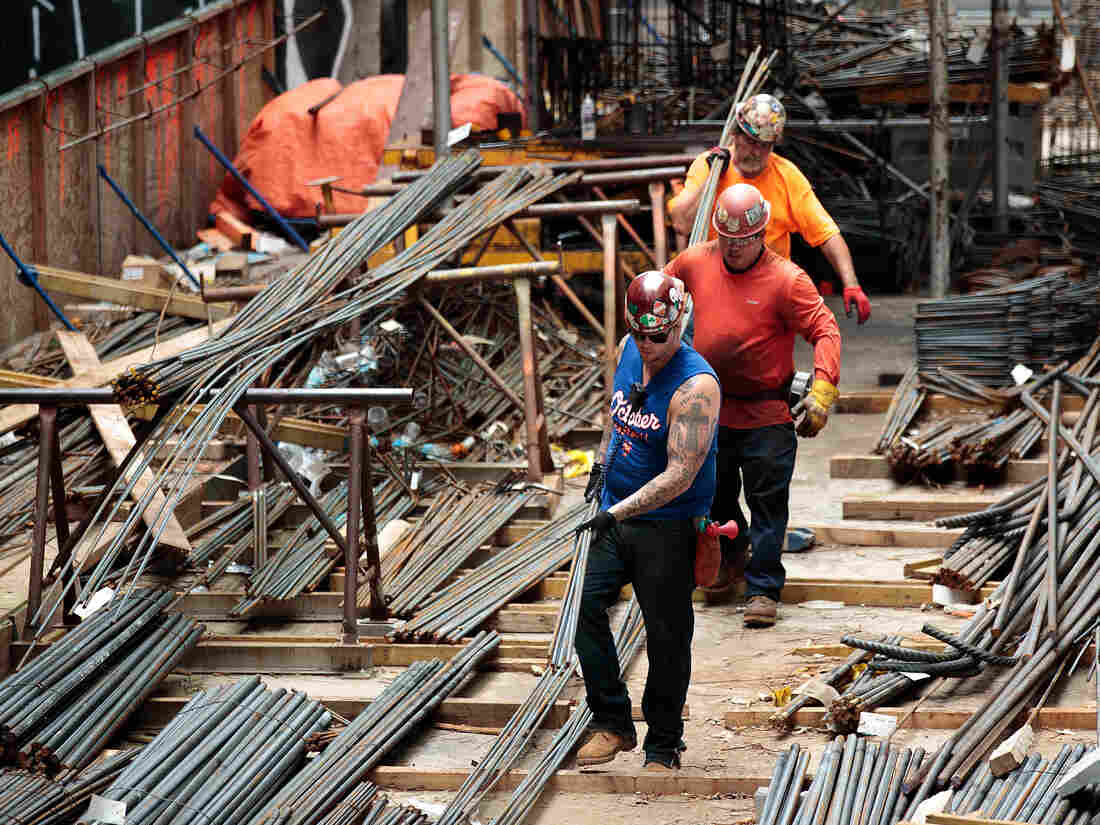 NEW YORK, NY - AUGUST 16: Construction laborers work on the site of a new residential building in the Hudson Yards development, August 16, 2016 in New York City.