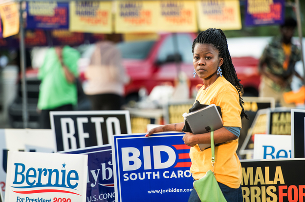 Kanesha Adams stands in the parking lot outside of Jim Clyburn's World-Famous Fish Fry on June 21 in Columbia, S.C. The event featured appearances by 21 Democratic presidential candidates seeking voters in the early primary state. (Sean Rayford for NPR)