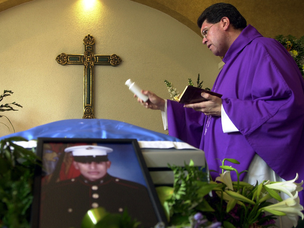 The funeral of Lance Cpl. Jose Antonio Gutierrez in 2003. Gutierrez was born in Guatemala and served in the Marine Corps until he was killed in Iraq — one of a number of immigrants in the military. (Moises Castillo/AP)