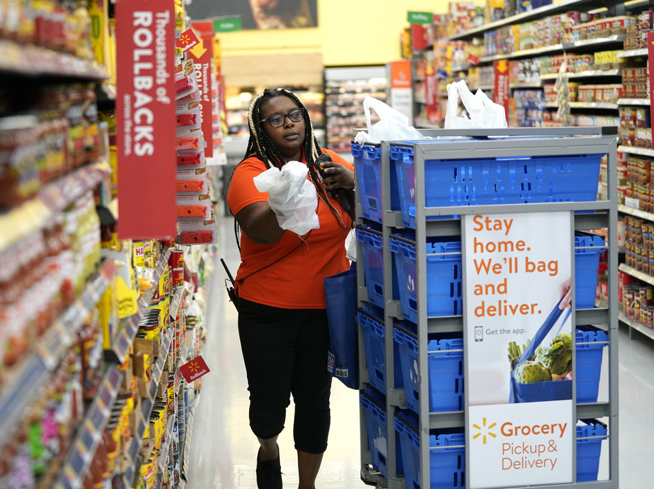 Walmart and Amazon began offering online purchases with food stamps in April as part of the USDA's pilot program. Now, both companies are expanding services for low-income shoppers. (David J. Phillip/AP)