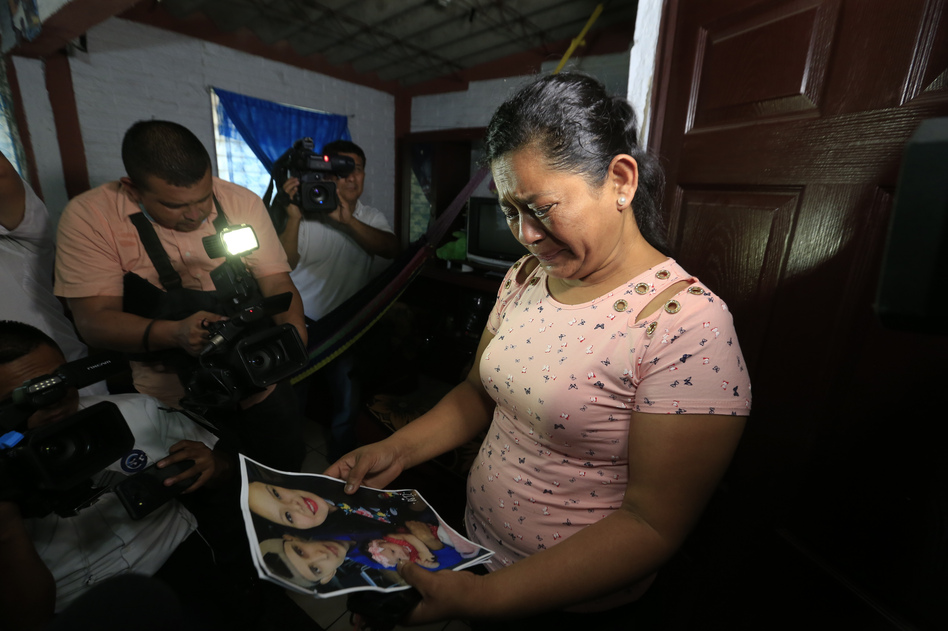 Rosa Ramírez cries as she looks at photos of her son Óscar Alberto Martínez Ramírez, 25, and granddaughter Valeria, nearly 2, while speaking to journalists at her home in San Martín, El Salvador, on Tuesday. The drowned bodies of her son and granddaughter were found Monday morning on the banks of the Rio Grande. (Antonio Valladares/AP)