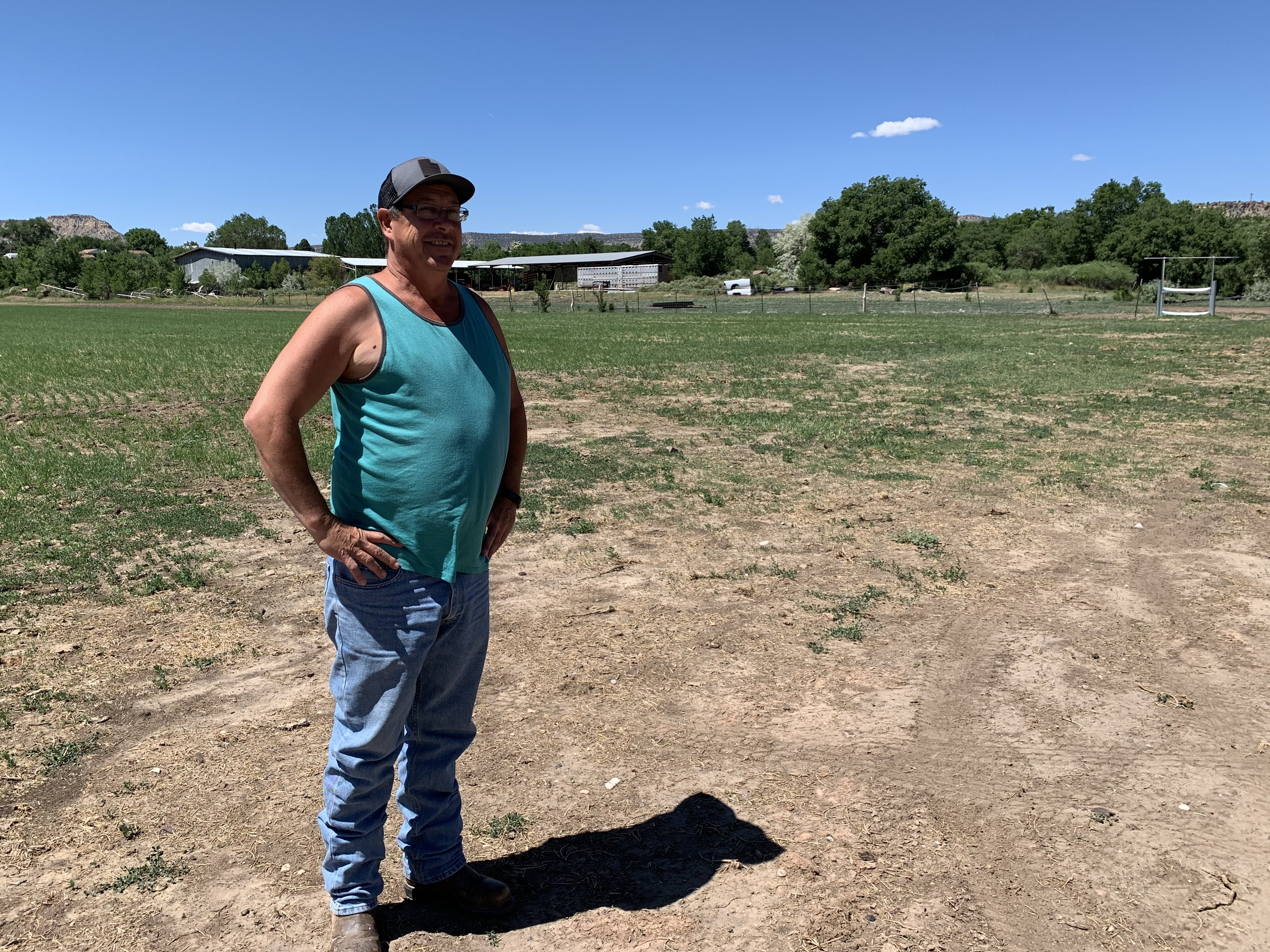 Shannon Steed stands on land that used to house his father's sawmill. The mill closed in the early 1990s due in part to a lack of available timber supply from nearby National Forest lands.