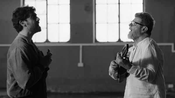 "Mateo Kingman (left) and Gustavo Santaolalla in the video for ""Último Aliento."""